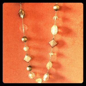 Long clear and grey glass bead necklace